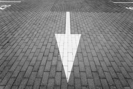 Driving direction arrow in the parking lot Stock Photo