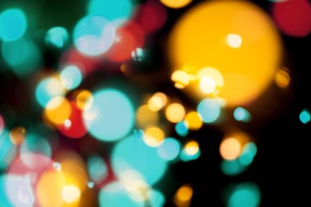 Blurred defocused bokeh lights on black background Stock Photo