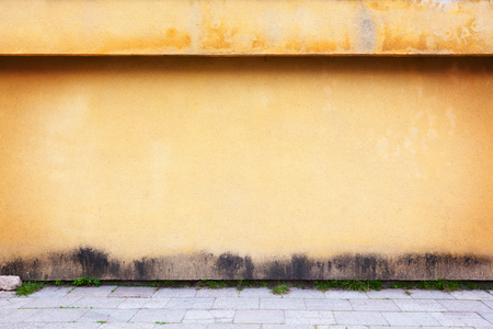 Simple urban wall with a sidewalk.