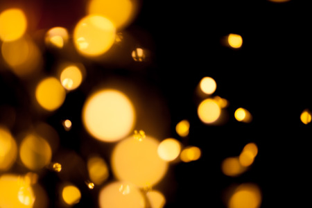 Blurred defocused bokeh lights on black background Standard-Bild
