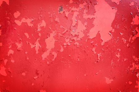 Old red paint, weathered and cracked, starting to fall off Stok Fotoğraf