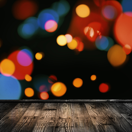 Close-up of a wooden floor with lights in the backgroundl