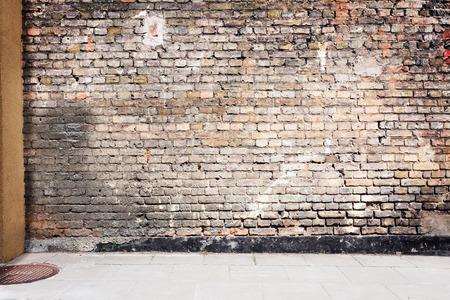 Simple urban wall with a sidewalk.