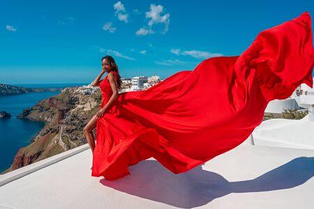 Beautiful Woman Run In Red Fluttering Dress. Slow Motion.