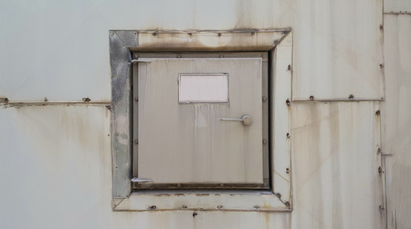 Gray squre manhole on wall can open close for maintenance inside kiln in factory