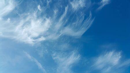 Blue sky with clouds background Standard-Bild - 128757365