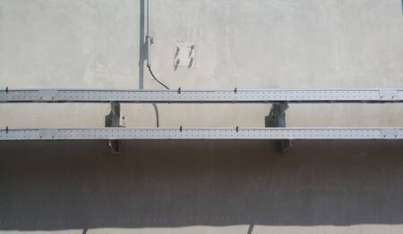 Cable ladders with cover on cement wall outside water pond , industial background 写真素材 - 143715938