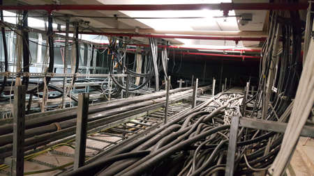 Electrical motor cable in cable room and Red pipe Fire fighting system (wet type) Stock Photo