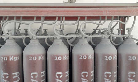 Fire fighting system red pipe have manual valves and pressure gauge to storage tank in factory Stock Photo