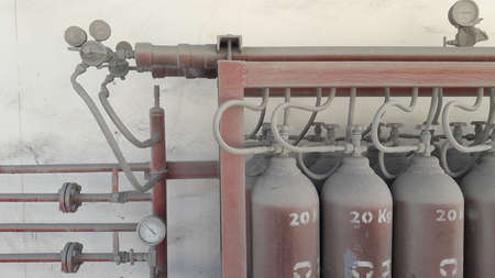 Fire fighting system red pipe have manual valves and pressure gauge to storage tank in factory
