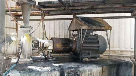 Electric motor on baseplate in pulp industial , motor under scaffolding platforms