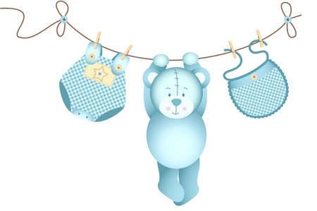 Teddy bear baby boy hanging on a clothesline