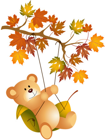Teddy bear swinging on autumn tree branch