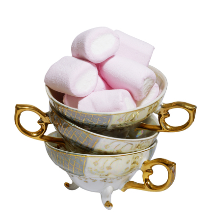 Stack of antique tea cups with marshmallows Stock Photo