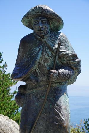 Standbeeld van een pelgrim op Kaap Finisterre
