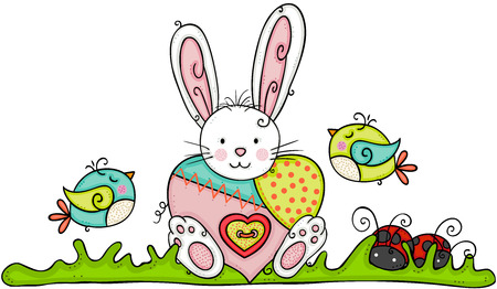Easter bunny with colorful heart in garden
