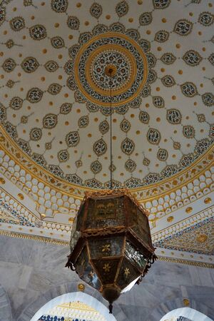 Istanbul, Turkey - August 31, 2019: Vintage classical lamp hanging under a ceiling on Topkapi Palace in Istanbul, Turkey.