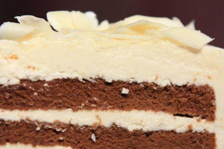 to cake layer: Torta di cioccolato-vaniglia strato  Archivio Fotografico