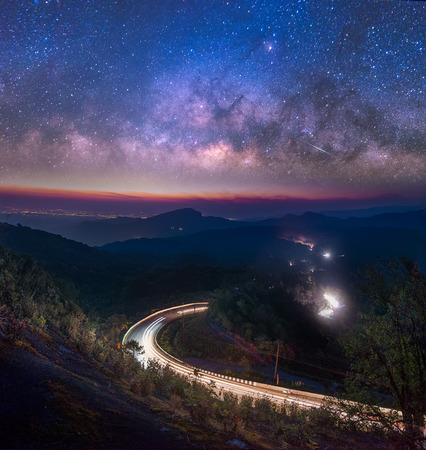 Milky Way Galaxy with street and light trails on Doi inthanon Chiang mai, Thailand. Stock Photo