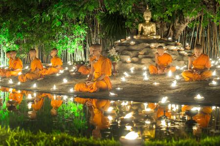 CHIANG MAI, THAILAND - JULY 20, 2016: The monks sit meditating on Asalha Puja Day at  Wat Pan Tao temple. Editorial