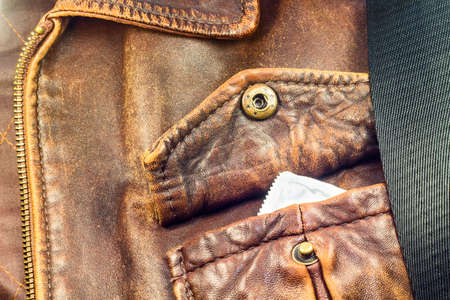 Condom in the pocket of leather jacket photo