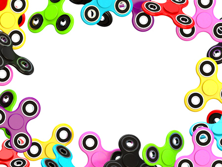 Colorful Fidget finger spinner stress, anxiety relief toy on white background.