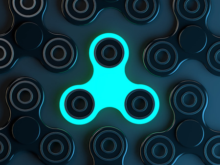 Luminous Fidget spinner stress relieving toy on dark background