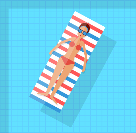 pool: Woman swimming in the pool on a mattress.