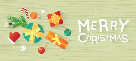 printed matter: Merry Christmas and Happy New Year. New Years toys, gifts on the wooden table top view and text. Postcard, banner, printed matter, greeting card. Flat design.