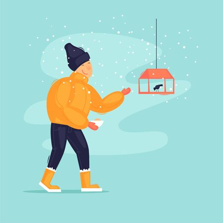 Guy feeds the birds in winter. Flat design vector illustration.