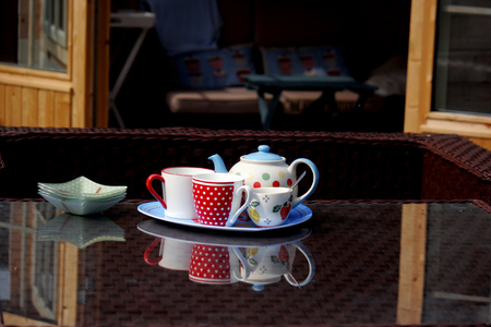 Afternoon tea served on the garden patio table