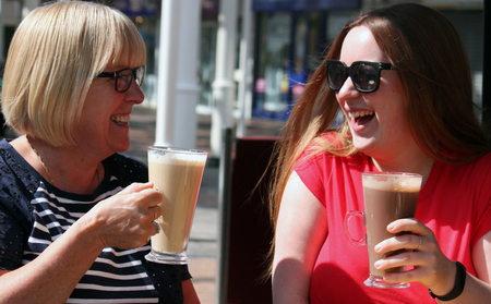 Mother and Daughter enjoying a coffee together, after a shopping trip