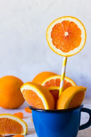 Orange slices in a cup