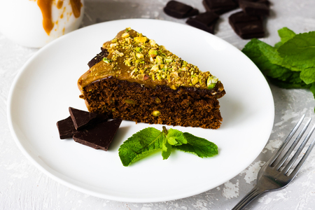 Chocolate cake with pistachios and salted caramel Stock Photo
