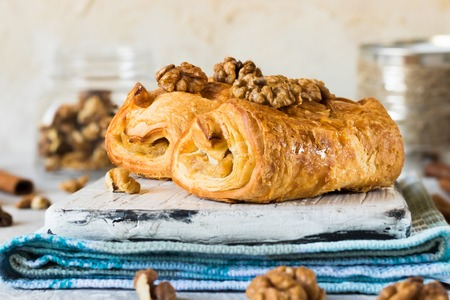 Puffs with maple syrup and walnuts Stock Photo