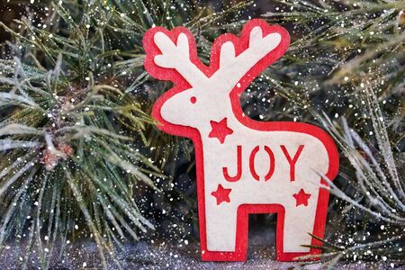 Christmas and Christmas decorative elements and toys on a wooden background