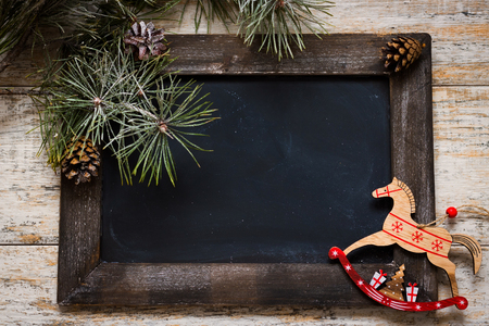 Chalkboard for records decorated with spruce branches and Christmas decorations