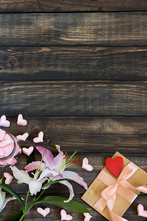 Flatley to the day of All Lovers on an aged wooden background
