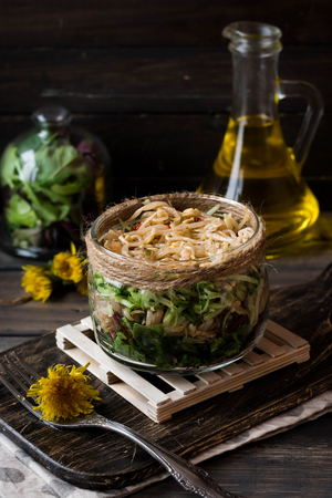 Vegetarian salad from soybean sprouts in a jar