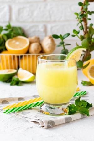 Ginger mint lemonade with lime and lemons for hot seasons
