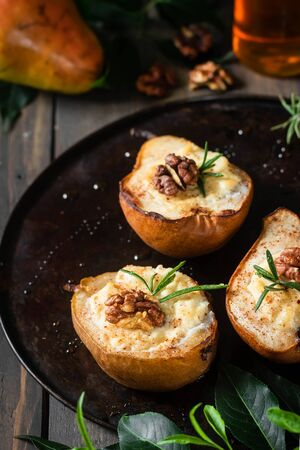Baked pears with ricotta, walnuts and honey. Light healthy dessert without sugar. A warming dish. Zdjęcie Seryjne