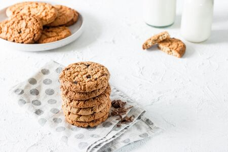 Classic pastries. Traditional oatmeal cookies with pieces of chocolate.