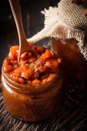 Pumpkin jam on a dark rustic background. Autumn harvest. Cozy autumn still life. Homemade preparations for the winter. Imagens - 129863383