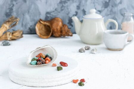 Fancy chocolates in the shape of sea pebbles. Фото со стока