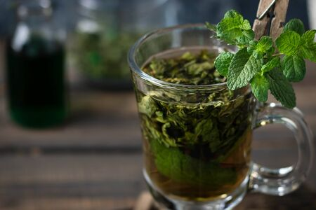 Soothing tea with fresh and fresh mint and mint syrup. A warm drink for the fall and winter seasons. The concept of caring for the emotional state. Фото со стока