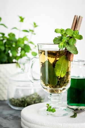 Soothing tea with fresh and fresh mint and mint syrup. A warm drink for the fall and winter seasons. The concept of caring for the emotional state. 写真素材