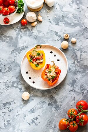Baked red and yellow peppers with champignons, tomatoes and chicken. Simple and tasty dish.