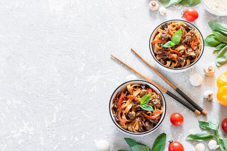 Udon wheat noodles with mushrooms and vegetables in tereyki sauce. Simple asian food.