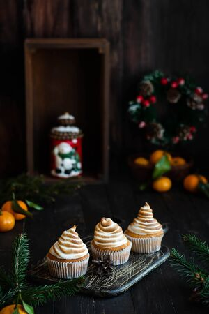 Citrus cupcakes with lemon curls and a cap from Swiss meringue