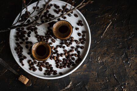 Coffee in glasses. Espresso on a dark background. Dark style
